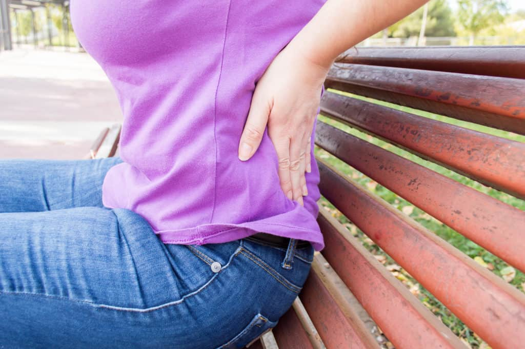 Do you have an Aching Back? - Woman with low back pain Fotolia 95795910